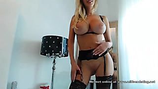 Nasty babe in sexy black lingerie teasing web cam users