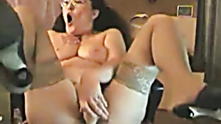 Old mature fingers her in front of pc watching porn