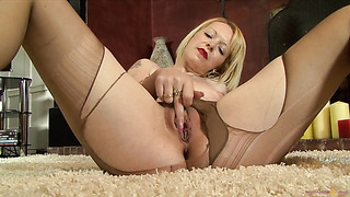 Blonde MILF in sexy pantyhose masturbates in high red heels