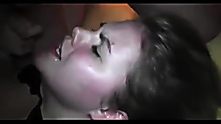 A lot of bukkake cumshot on her young face