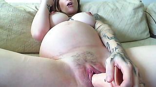 Pregnant chick toys her soon mom pussy with big dildo